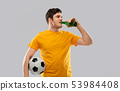man or football fan with soccer ball drinking beer 53984408