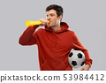 football fan with soccer ball blowing horn 53984412