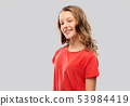 smiling teenage girl in red t-shirt winking 53984419