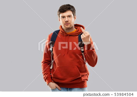 male student with school bag showing middle finger 53984504