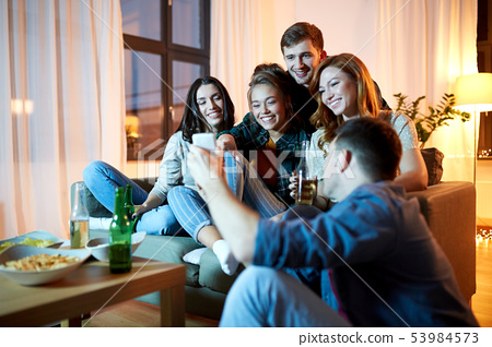 happy friends with smartphone at home party 53984573