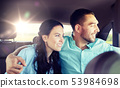 happy man and woman hugging on taxi back seat 53984698