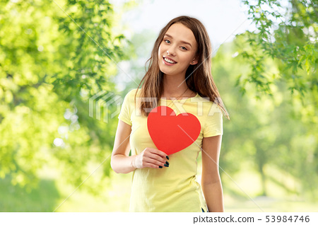 smiling teenage girl with red heart 53984746