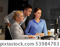 business team with computer working late at office 53984763