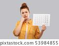 sad red haired teenage girl with calendar sheet 53984855
