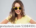 teenage girl in yellow sunglasses and t-shirt 53984991