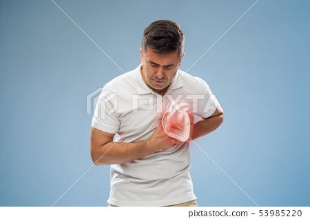 unhappy man having heart attack or heartache 53985220