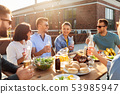 happy friends with drinks or bbq party on rooftop 53985947