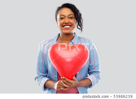 african american woman with heart-shaped balloon 53986239