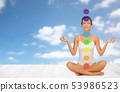 woman in lotus pose doing yoga with seven chakras 53986523