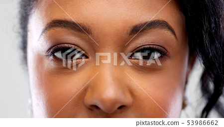 close up of african american woman face 53986662