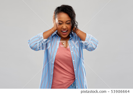 african american woman closing ears by hands 53986664