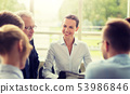 smiling business people meeting in office 53986846