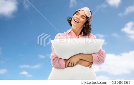 woman with pillow in pajama and eye sleeping mask 53986865