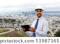 architect or businessman in helmet with tablet pc 53987365