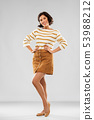 young woman in striped pullover, skirt and shoes 53988212