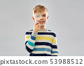 curious boy looking through magnifying glass 53988512