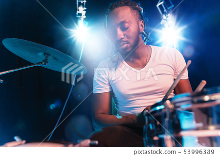Young african-american jazz musician playing drums 53996389