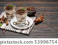 Classic tiramisu dessert in a glass on wooden background 53996754