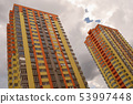 Colourful high residential buildings. 53997448