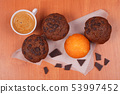 Cup of coffee and muffins on the table. 53997452