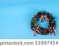 Christmas wreath on blue background. 53997454