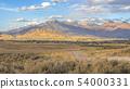Homes near mountain under sunny sky in Utah Valley 54000331