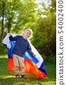 Portrait of cute little boy in public summer park 54002400