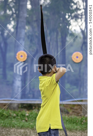 Asian boys are archery in camp adventure. 54008841
