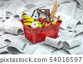 Shopping basket with foods on the pile of receipt. 54016597