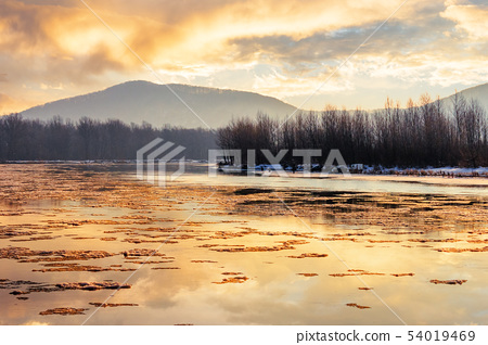 river in mountain at winter sunset 54019469