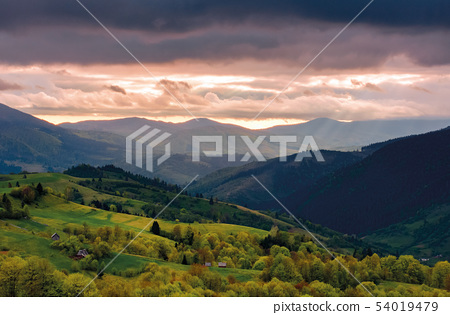 mountain rural area in springtime at cloudy sunset 54019479