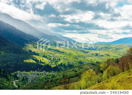 road through the village in valley of Carpathians 54019480