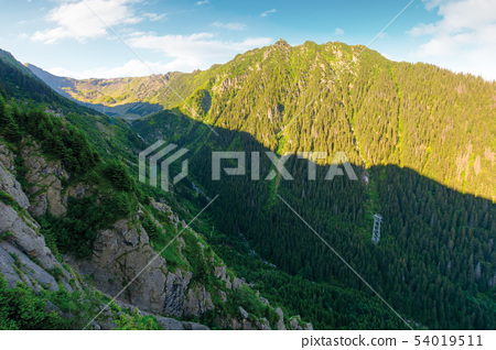mountain ridge with rocky cliffs and grassy slopes 54019511