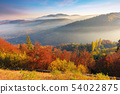 foggy autumn scenery in mountains at sunrise 54022875