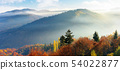 foggy autumn scenery in mountains at sunrise 54022877