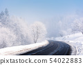 road turn in to the forest in winter 54022883