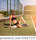 Slim young girl athlete tennis player is on the 54027237