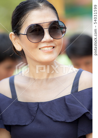 toothy smiling face of beautiful asian woman 54031599