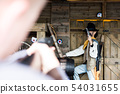 Blurry Man at Foreground Aiming at Clear Ranch 54031655