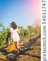 Beautiful Young Adult Woman Enjoying Glass of Wine 54031747
