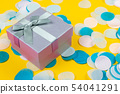 Present box on yellow background with multicolored 54041291