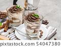 Classic tiramisu dessert in a glass and coffee makeron concrete background 54047380