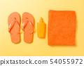 Orange flip flops with towel on yellow background 54055972