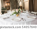 Wedding table setting decorated with fresh flowers 54057640