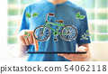 Eco bicycle with man using a tablet 54062118