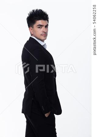 Business Man Stand in dark Black proper Suit 54062258
