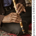 Iranian Hill Tribe Man Plays His Flute 54064050