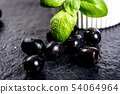 Black olives on black stone 54064964