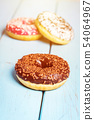 Sweet donuts on black stone table 54064967